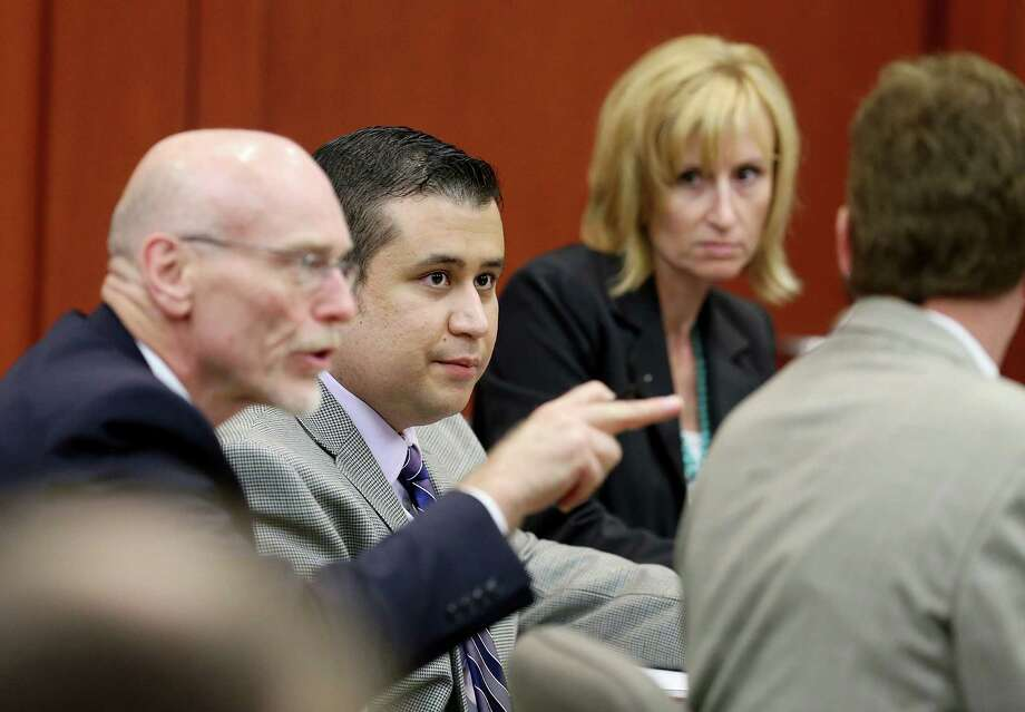 SANFORD, FL - JUNE 27:  George Zimmerman glances at his defense team during George Zimmerman's trial in Seminole circuit court June 27, 2013 in Sanford, Florida. Zimmerman is charged with second-degree murder for the February 2012 shooting death of 17-year-old Trayvon Martin. (Photo by Jacob Langston-Pool/Getty Images) ORG XMIT: 171607706 Photo: Pool / 2013 Getty Images