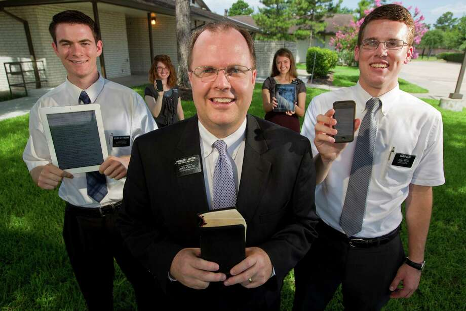 Brian Ashton leads one of three groups of Mormon missionaries in the Houston area. Among them: Elders Michael Case, 20, left, Kyle Nottingham, 21, right, and Sisters Staci Petersen, 20, left rear, and Michaelah Thompson, 19, in Sugar Land. Photo: Johnny Hanson, Staff / © 2013  Houston Chronicle