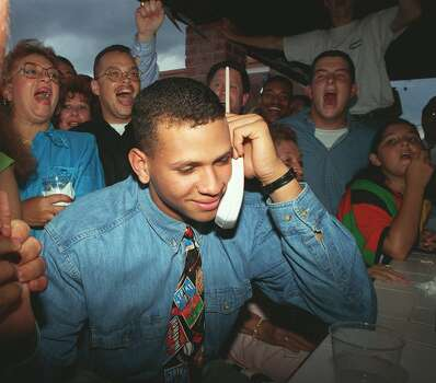 In Seattle, we have Alex Rodriguez. The Mariners's and baseball's first-round pick in 1993. (Pictured here when he got the call from the club.) Seattle watched him go from callow youth to callow adult. A-Rod became Pay-Rod to Seattle after he spurned Seattle for more money and Texas. We didn't understand either choice. The rest of the world has apparently joined Seattle in its feelings toward him. Photo: MARTA LAVANDIER, Associated Press / AP