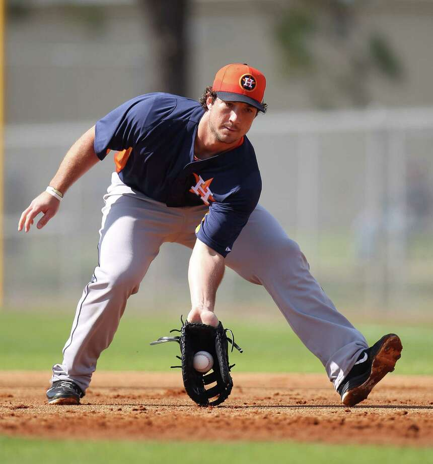 Brett Wallace is getting a second chance this season to show the Astros his offensive skills while sharing time at a congested first base. Photo: Karen Warren, Staff / © 2013 Houston Chronicle