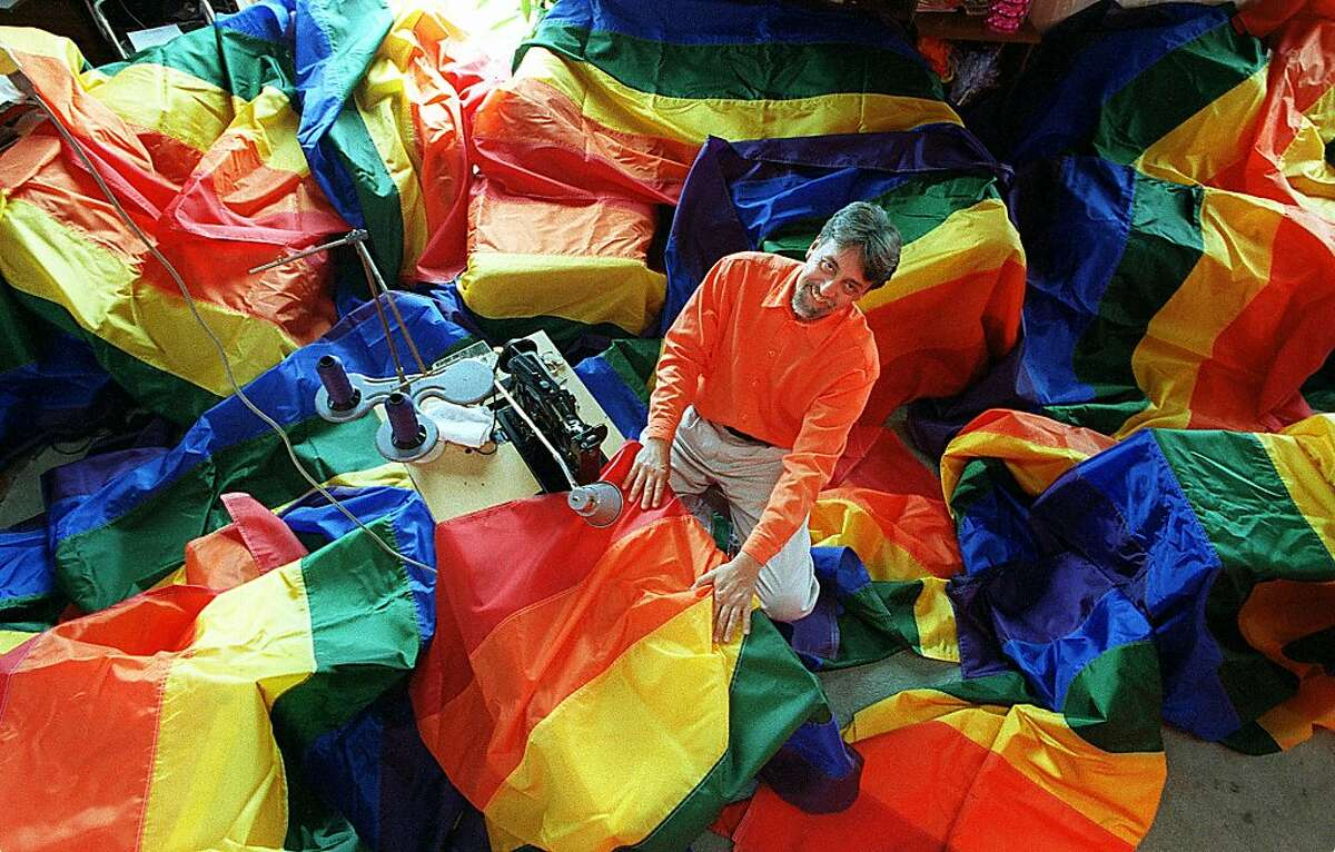 """PRIDE/C/10JUN98/EZ/JLT """"Seam-master"""" Gilbert Baker in his studio amid some of the 500 rainbow flags which will festoon the City for the annual Gay Pride Parade. Baker is the original creator of the rainbow flag. 40 Isis Street PHOTO BY JERRY TELFER"""