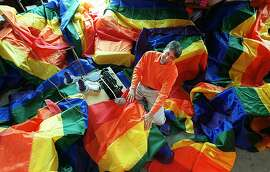 "PRIDE/C/10JUN98/EZ/JLT   ""Seam-master"" Gilbert Baker in his studio amid some of the 500 rainbow flags which will festoon the City for the annual Gay Pride Parade.  Baker is the original creator of the rainbow flag.   40 Isis Street   PHOTO BY JERRY TELFER"