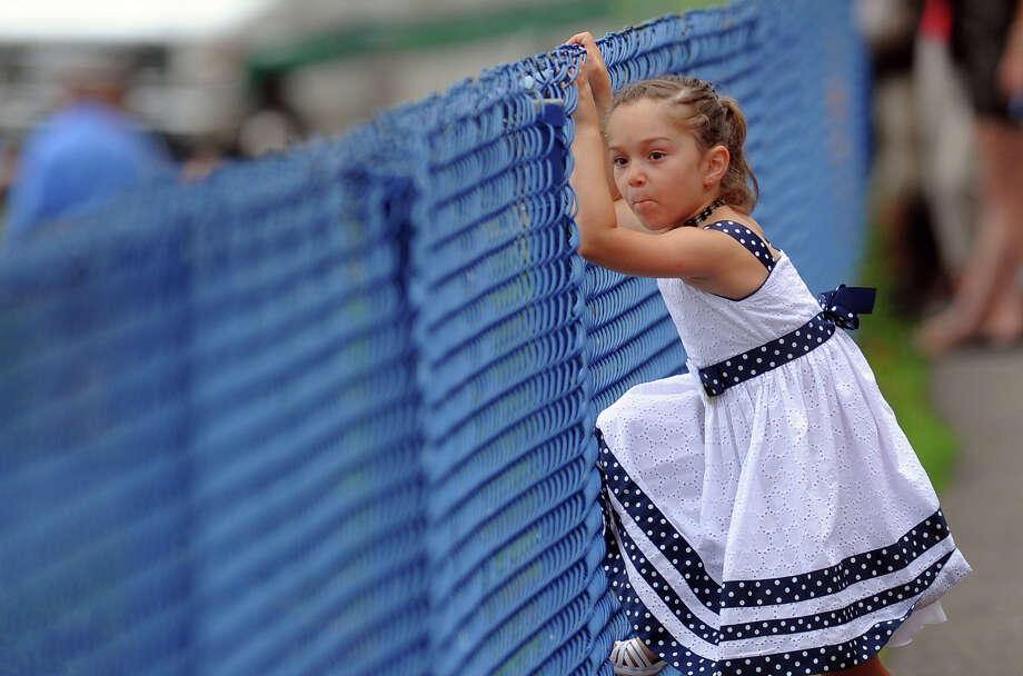 Ariana Rivera, 5, watches for her aunt Olivia Tabaka who's graduating in Seymour High School's 126th Annual Commencement in Seymour, Conn. on Thursday June 27, 2013. Photo: Christian Abraham / Connecticut Post
