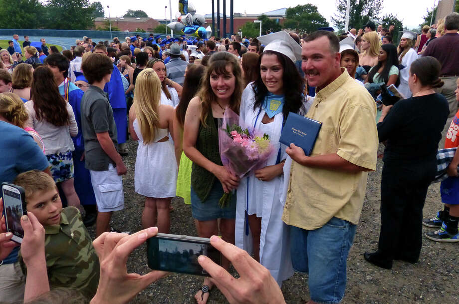 Graduate Julianne Chacho poses for photos with her family after Seymour High School's 126th Annual Commencement in Seymour, Conn. on Thursday June 27, 2013. Photo: Christian Abraham / Connecticut Post