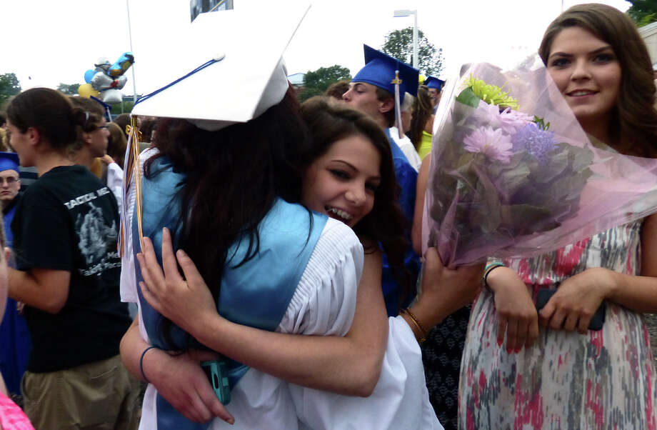 Graduate Julianne Chacho gets a hug after Seymour High School's 126th Annual Commencement in Seymour, Conn. on Thursday June 27, 2013. Photo: Christian Abraham / Connecticut Post