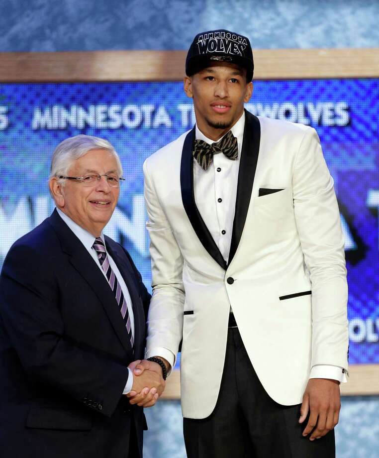 NBA Commissioner David Stern, left, shakes hands with Colorado's Andre Roberson, who was selected by the Minnesota Timberwolves in the first round of the NBA basketball draft, Thursday, June 27, 2013, in New York. (AP Photo/Kathy Willens) Photo: Kathy Willens, Associated Press / AP
