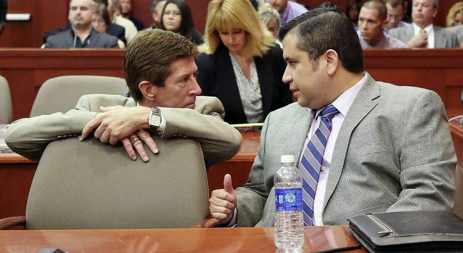 George Zimmerman, right, speaks with defense attorney Mark O'Mara during his trial in Seminole circuit court in Sanford, Fla., on Thursday. Photo: Jacob Langston, POOL / Pool Orlando Sentinel