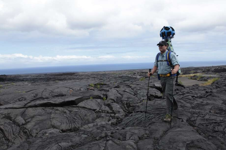 Google this: Rob Pacheco, president of Hawaii Forest & Trail, walks across hardened lava at Hawai'i Volcanoes National Park with the 40-pound Street View Trekker gear on his back.