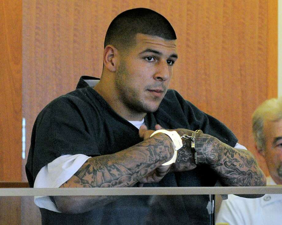 Former New England Patriots football tight end Aaron Hernandez stands during a bail hearing in Fall River Superior Court Thursday, June 27, 2013 in Fall River, Mass. Hernandez, charged with murdering Odin Lloyd, a 27-year-old semi-pro football player, was denied bail. (AP Photo/Boston Herald, Ted Fitzgerald, Pool) ORG XMIT: MABOH101 Photo: Ted Fitzgerald / Pool, Boston Herald