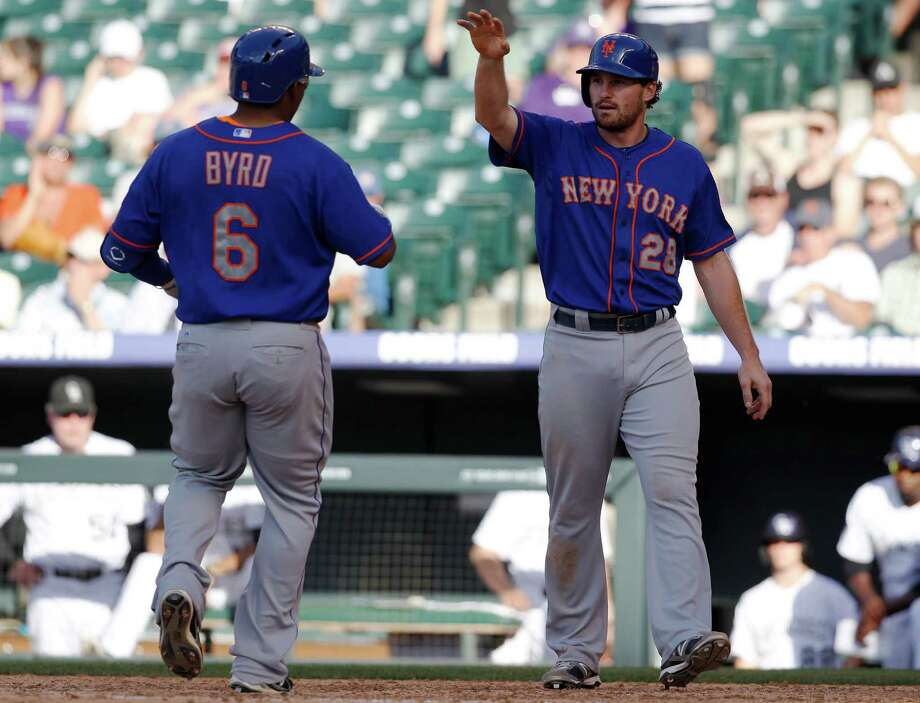 New York Mets' Daniel Murphy, right, congratulates Marlon Byrd as he crosses home plate after hitting a two-run home run to bring in Murphy against the Colorado Rockies during the eighth inning of the Mets' 3-2 victory in a baseball game in Denver on Thursday, June 27, 2013. (AP Photo/David Zalubowski) ORG XMIT: CODZ114 Photo: David Zalubowski / AP