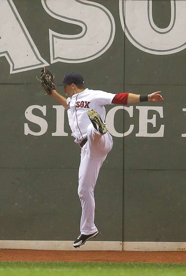 BOSTON, MA - JUNE 27: Daniel Nava #29 of the Boston Red Sox makes leaping catch on a ball hit by Edwin Encarnacion #10 of the Toronto Blue Jays in the 8th inning at Fenway Park on June 27, 2013 in Boston, Massachusetts.  (Photo by Jim Rogash/Getty Images) ORG XMIT: 163494291 Photo: Jim Rogash / 2013 Getty Images