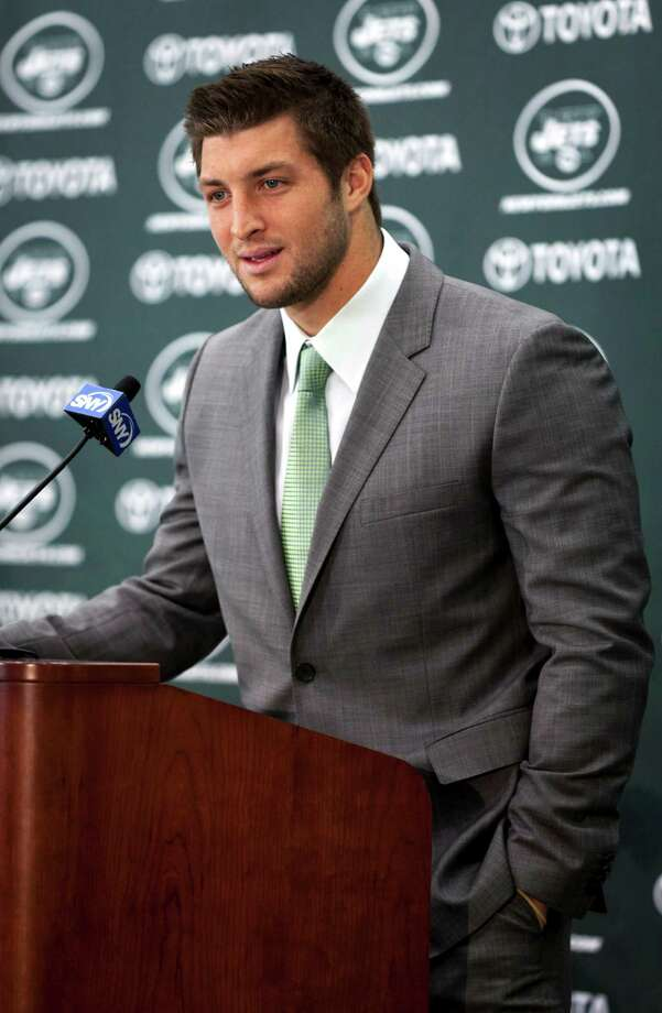 FILE -- Tim Tebow speaks at a news conference after being introduced as a quarterback for the New York Jets in Florham Park, N.J., on March 26, 2012. The Jets cut Tebow on Monday April 29, 2013, after drafting Geno Smith on Friday, which raised the number of quarterbacks on their roster to six. (Richard Perry/The New York Times) Photo: RICHARD PERRY / NYTNS