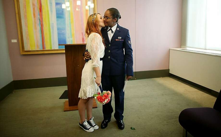 NEW YORK, NY - JUNE 27:  U.S. Air Force Senior Airman Shyla Smith (R) and Courtney Burdeshaw kiss in the west chapel moments after they were wed at the Manhattan Marriage Bureau the day after the U.S. Supreme Court ruling on DOMA on June 27, 2013 in New York City. The high court struck down the Defense of Marriage Act (DOMA) and ruled that supporters of California's ban on gay marriage, Proposition 8, could not defend it before the Supreme Court.  The pair said they planned to get married today before the ruling came down.  (Photo by Mario Tama/Getty Images)  Photo: Mario Tama, Getty Images