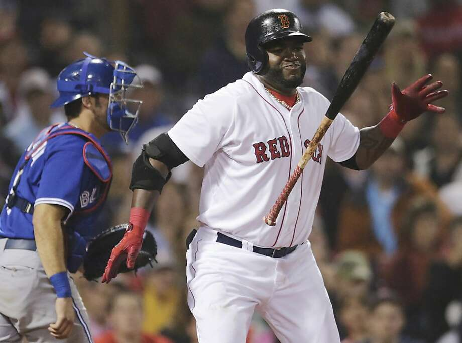 Boston Red Sox designated hitter David Ortiz reacts after striking out to end the seventh inning of a baseball game against the Toronto Blue Jays at Fenway Park, Thursday, June 27, 2013, in Boston. At left is Blue Jays catcher J.P. Arencibia. (AP Photo/Charles Krupa) Photo: Charles Krupa, Associated Press