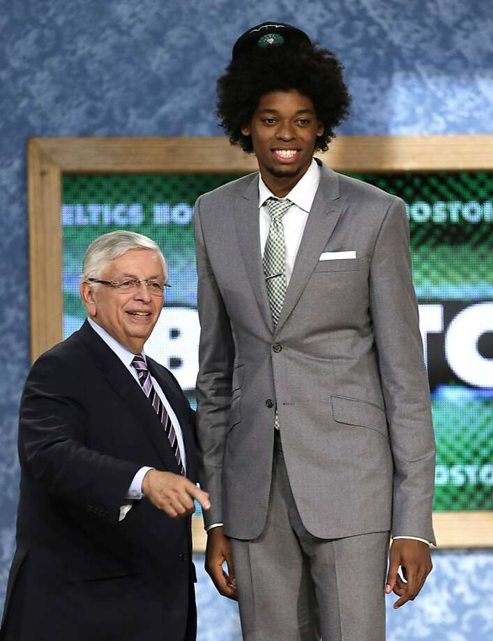 NBA Commissioner David Stern, left, stands with Lucas Nogueira, of Brazil, who was selected by the Boston Celtics in the first round of the NBA basketball draft, Thursday, June 27, 2013, in New York. (AP Photo/Kathy Willens) Photo: Kathy Willens, Associated Press