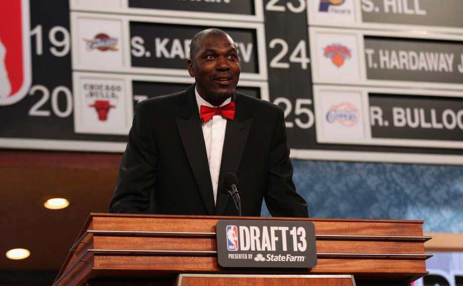 Hakeem Olajuwon speaks on stage during the 2013 NBA Draft.