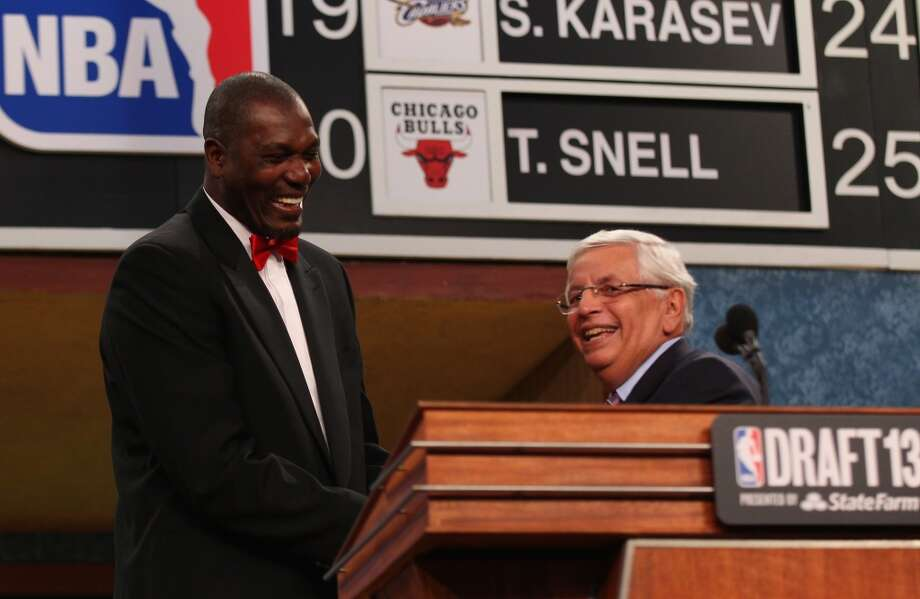 Hakeem Olajuwon greets NBA Commissoner David Stern during the 2013 NBA Draft.