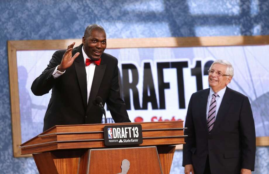 Retired NBA star Hakeem Olajuwan, left, pays tribute to NBA Commissioner David Stern at the end of the first round.