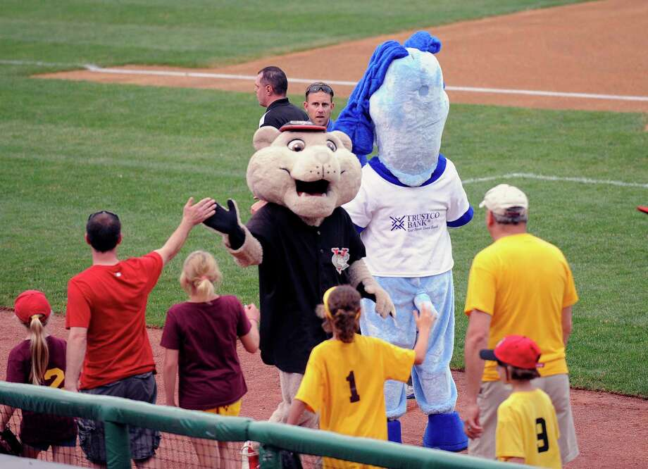Tri-City Valley Cats mascots great fans before playing the Lowell Spinners during their minor league baseball game in Troy, N.Y., Thursday, June 27, 2013. (Hans Pennink / Special to the Times Union) ORG XMIT: HP101 Photo: Hans Pennink / Hans Pennink