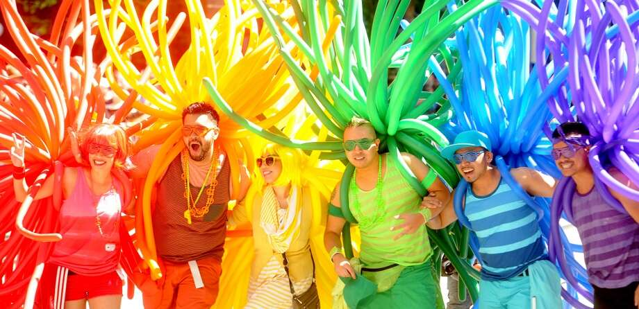 Revelers with balloons create a human rainbow during San Francisco's 42nd annual Pride Parade on Sunday, June 24, 2012.