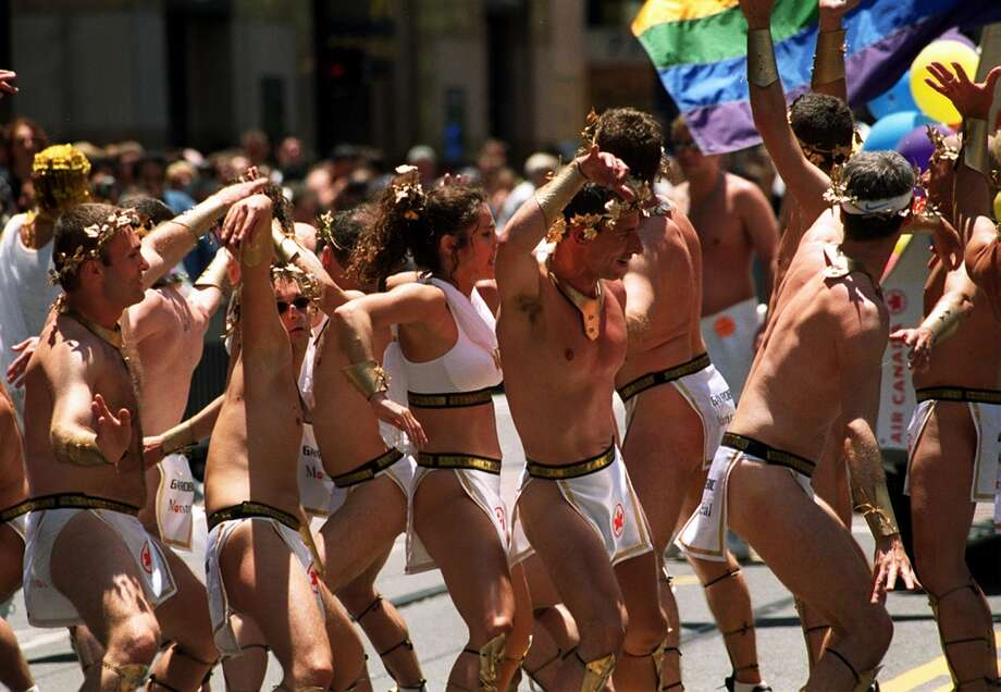 Dancers from Montreal salute San Francisco while making their way down Market Street  in the 2000 San Francisco Pride Parade.