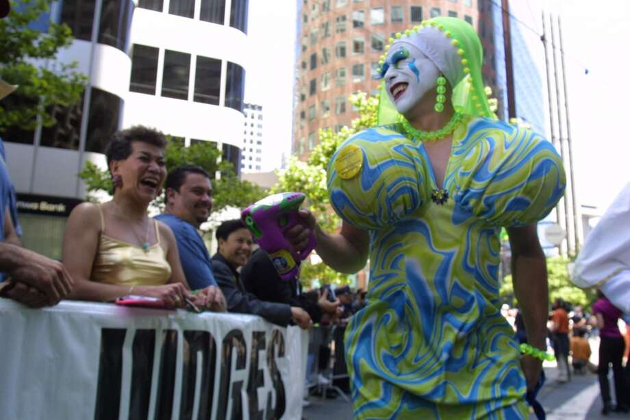A Sisters of Perpetual Indulgence struts her stuff for the judges on Market Street during the annual S.F. Pride Parade in 2001.