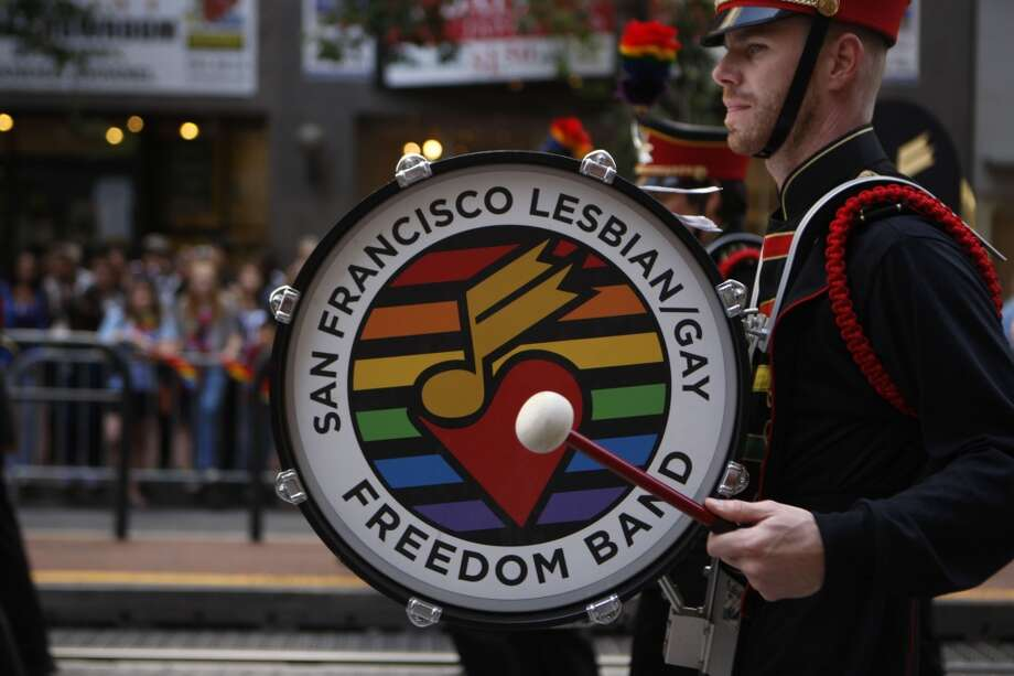 A bass drummer marches with the San Francisco Lesbian/Gay Freedom Band in the 41st San Francisco Pride Parade.