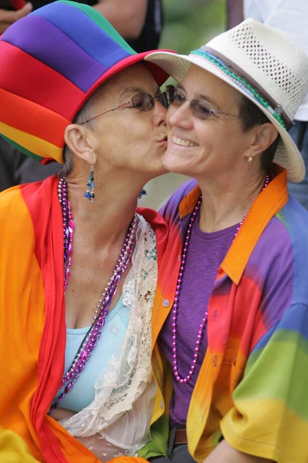Married in 2004, then again in 2008, Kathryn Mudie, left, and Susan McDaniel of Novato share a kiss before the start of the Pride Parade on Market Street in 2009.
