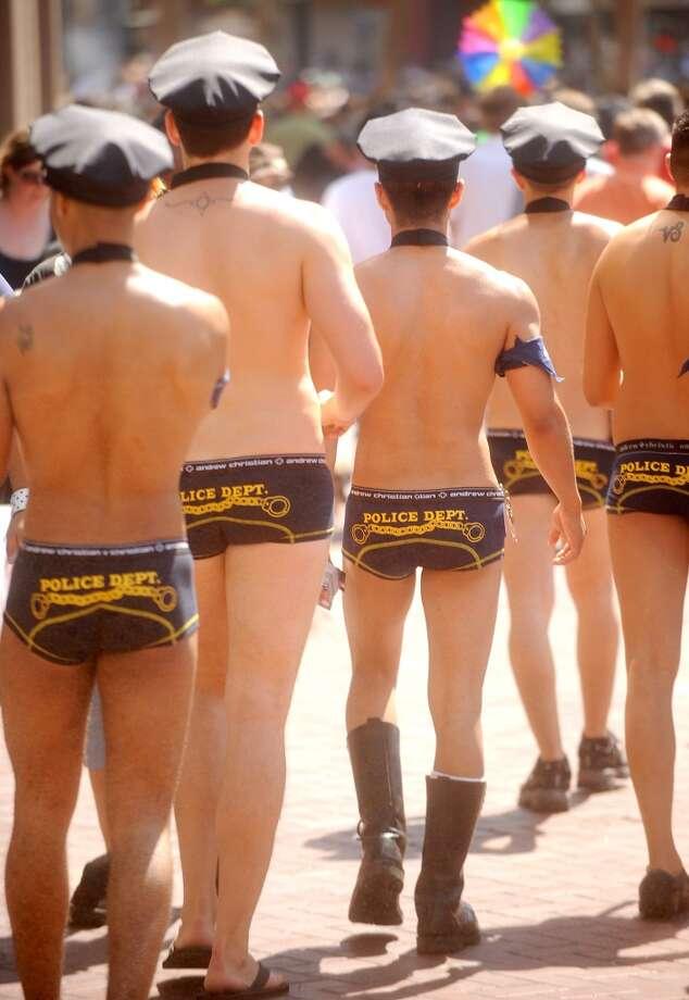 Mock cops make their way to the 2009 Pride Parade in San Francisco.