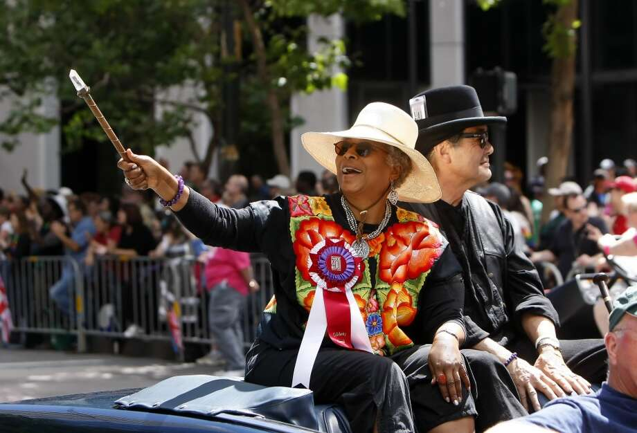 Grand marshal Alice Walker blows kisses to the thousands in the crowd watching the 40th annual Pride Parade in 2010.