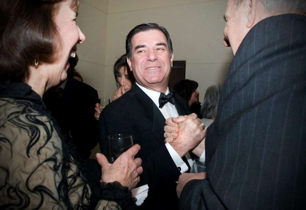 """Mayor Michael Pavia shakes hands with Tom McKiernan, of Stamford, as he celebrates at """"A Thousand Stars Shine Together"""", A Gala Inaugural Celebration at The Palace Theater in Stamford, Conn. on Friday, Jan. 15, 2010."""