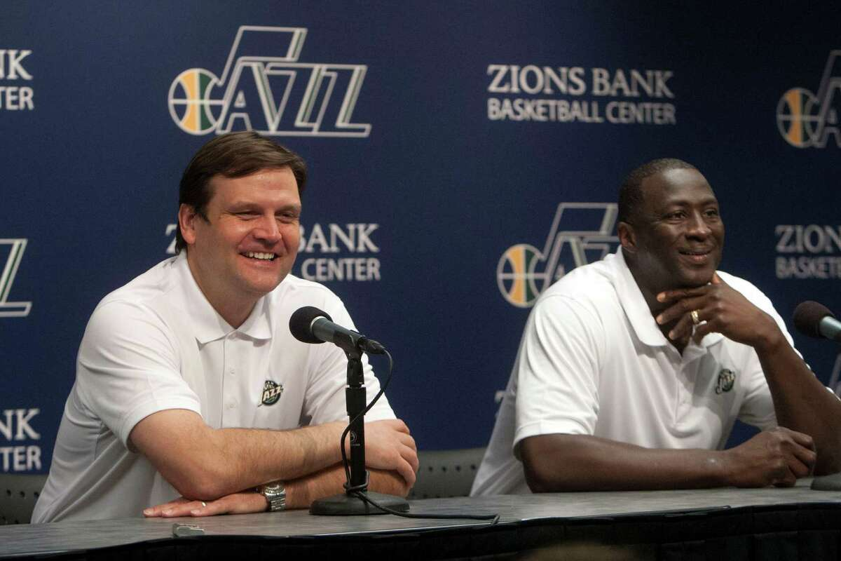 Jazz general manager Dennis Lindsey and Utah Jazz head coach Tyrone Corbin talk during a press conference at the Zions Bank Basketball Center during the NBA draft Thursday June 27, 2013. (AP Photo/The Salt Lake Tribune, Chris Detrick)