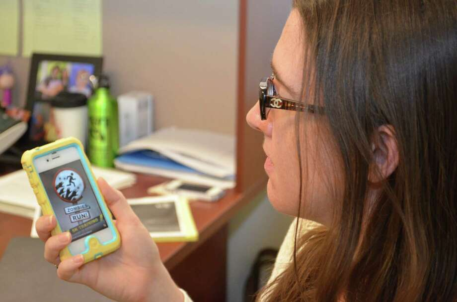 """Elizabeth Lyons, a behavioral science researcher at University of Texas Medical Branch at Galveston, has developed a smartphone game - """"Zombies, Run"""" - to encourage people to increase their activities levels. Photo: Molly Dannenmaier/UTMB Galveston"""
