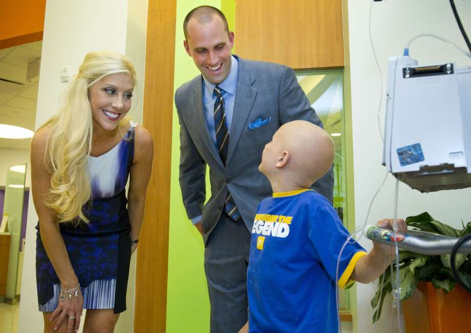 Laurie and Matt Schaub greet Jonathan Davis, 9, during a visit to Texas Children's Hospital West Campus Thursday, June 27, 2013, in Houston. The Schaubs announced during a news conference a $250,000 donation for emergency center expansion. The donation comes through the Gr8Hope Foundation. ( Brett Coomer / Houston Chronicle )