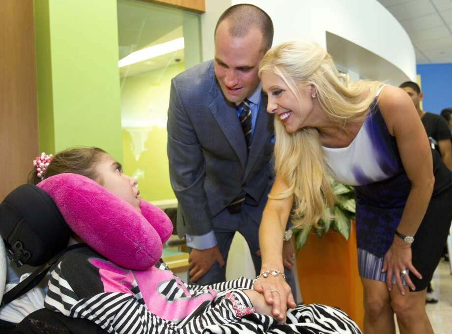 Houston Texans quarterback Matt Schaub and his wife, Laurie, greet Lauren Kainer, 17, during a visit to Texas Children's Hospital West Campus Thursday, June 27, 2013, in Houston. The Schaubs announced during a news conference a $250,000 donation for emergency center expansion. The donation comes through the Gr8Hope Foundation. ( Brett Coomer / Houston Chronicle )