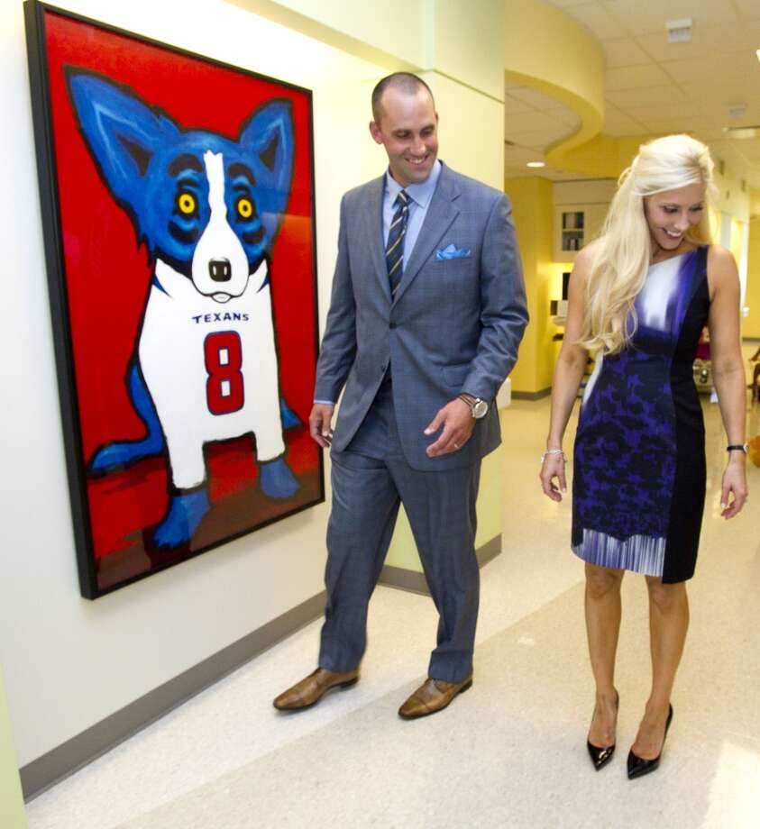 Houston Texans quarterback Matt Schaub and his wife, Laurie, walk through the halls of Texas Children's Hospital West Campus Thursday, June 27, 2013, in Houston. The Schaubs announced a $250,000 donation for emergency center expansion. The donation comes through the Gr8Hope Foundation. ( Brett Coomer / Houston Chronicle )
