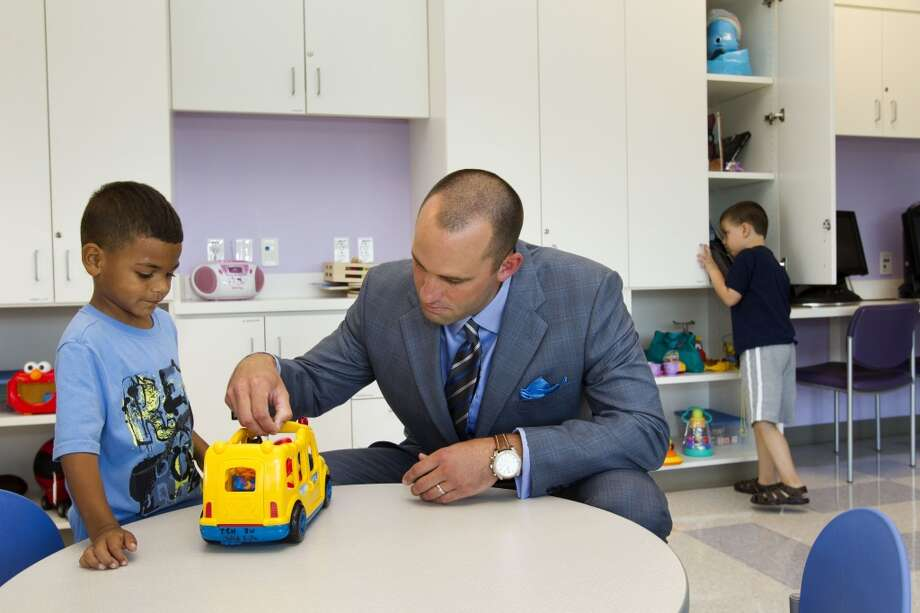 Houston Texans quarterback Matt Schaub visits with Jaiden Horn in a playroom at Texas Children's Hospital West Campus Thursday, June 27, 2013, in Houston. Schaub and his wife, Laurie, announced during a news conference a $250,000 donation for emergency center expansion. The donation comes through the Gr8Hope Foundation. ( Brett Coomer / Houston Chronicle )