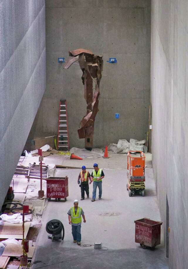 A twisted steel column from the World Trade Center (WTC) site is shown in its permanent location at the 911 Memorial Museum on Thursday, June 27, 2013 in New York.  Recovered from the WTC site after September 11, 2001, this column once stood in the core of the South Tower.  (AP Photo/Bebeto Matthews) ORG XMIT: NYBM102 Photo: Bebeto Matthews, AP / AP