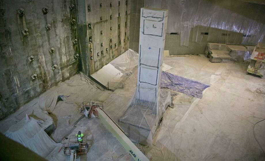 The Slurry Wall, left, part of the World Trade Center's original foundation, is shown during ongoing construction at the 911 Memorial Museum on Thursday, June 27, 2013 in New York.  Recovered from the WTC site after September 11, 2001, the wall was built to keep the Hudson River from flooding the site by creating a bathtub-like enclosure.  (AP Photo/Bebeto Matthews) ORG XMIT: NYBM103 Photo: Bebeto Matthews, AP / AP