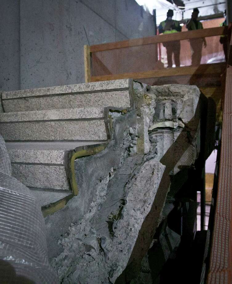 "Part of a stairway from the World Trade Center (WTC) site is shown in its permanent location at the 911 Memorial Museum on Thursday, June 27, 2013 in New York.  Recovered from the WTC site after September 11, 2001, this stairway offered a clear exit from the World Trade Center Plaza to Vesey Street, providing a means of escape for hundreds fleeing from the Towers.  It became symbolic of survival and acquired the name ""Survivors' Stairs.""   (AP Photo/Bebeto Matthews) ORG XMIT: NYBM104 Photo: Bebeto Matthews, AP / AP"