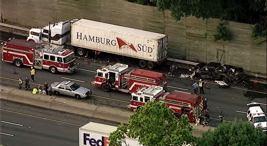 One person was killed on I-95 Northbound in Greenwich, Conn. on Friday, June 28,2013 in a crash involving two tractor trailers and a service truck, according to State Police. The northbound accident happened around 2:45 a.m. Behind the truck is the badly-burned service truck. Photo: Contributed Photo, Photo From WABC TV In New York / Connecticut Post Contributed