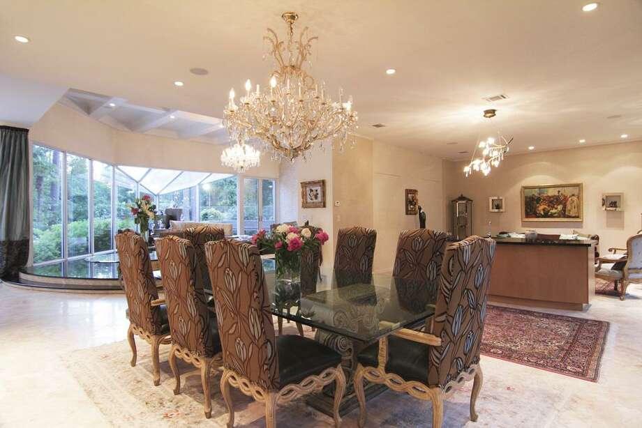 Elegant formal dining room adjoins great room and formal living room. Twenty four armed handing chandelier.