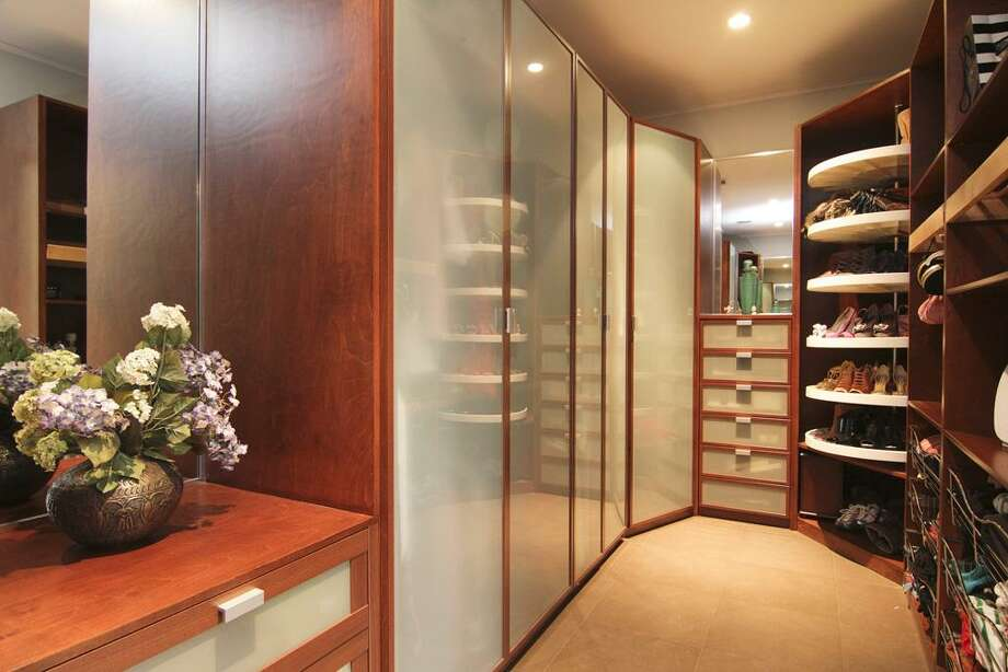 Oversized walk in closet w/ abundant built in storage & organizational systems.