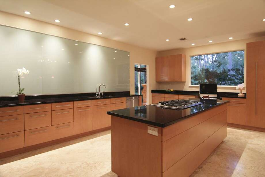 Recessed lighting, surround sound speakers, upper and lower cabinets w/ brushed nickel hardware.