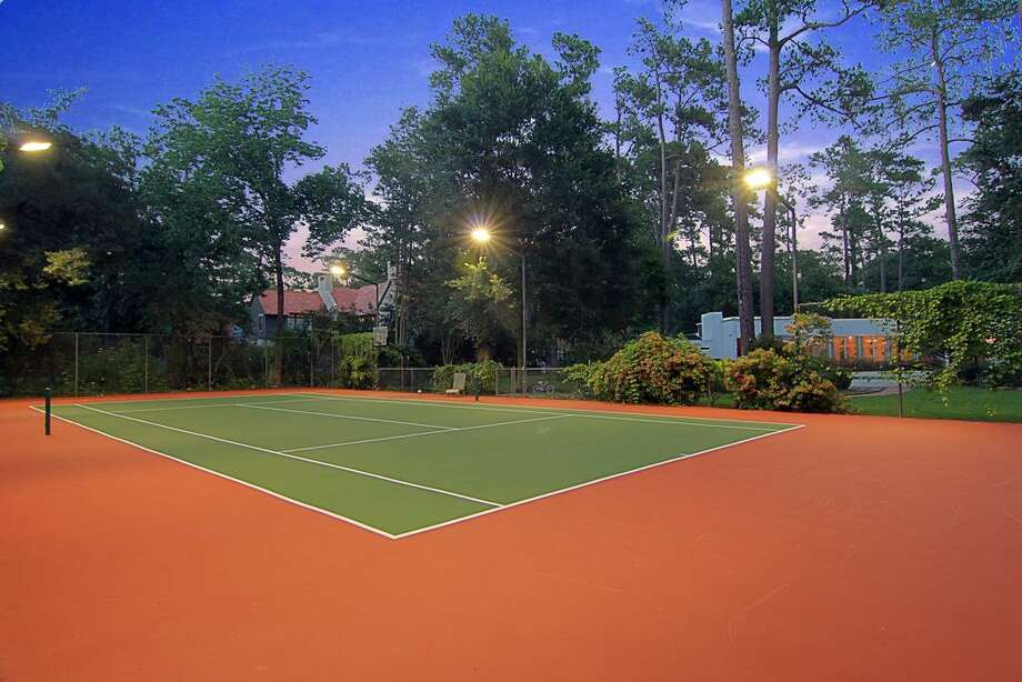 Rare find! Immaculate fully fenced tennis court w/ basketball goal.