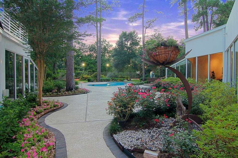 Fabulous landscaping w/ winding walkways throughout backyard.