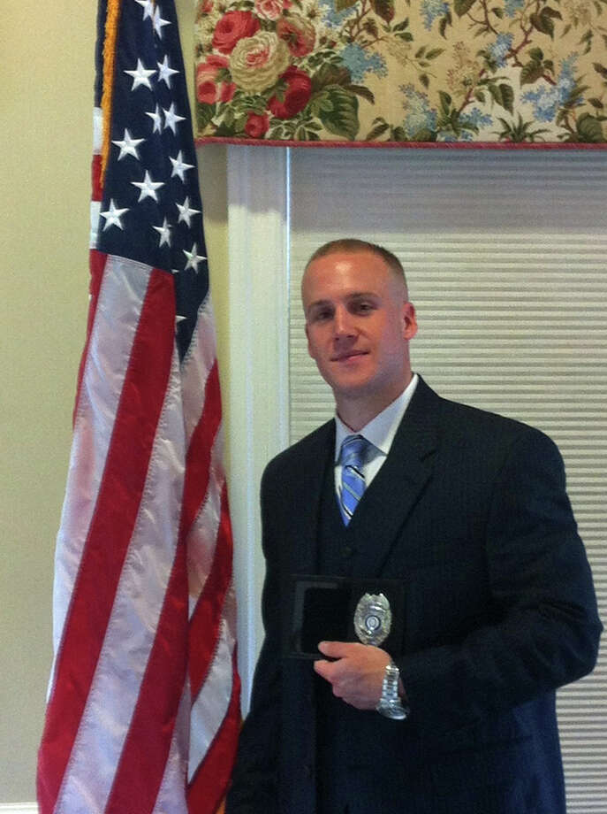 Probationary Officer Thomas Callinan was sworn in to the New Canaan Police Department on June 27 at the Lapham Community Center. Photo: Contributed Photo
