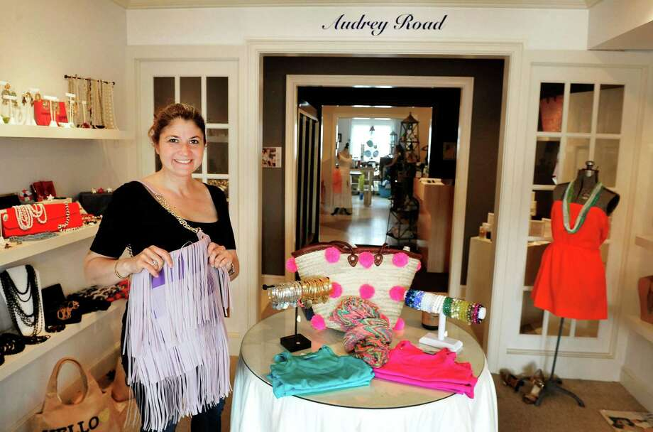 Danielle Verrilli holds a Remi & Reid fringe bag at Audrey Road, her vintage themed-boutique in Ridgefield, Conn. Friday, June 28, 2013. Photo: Michael Duffy / The News-Times