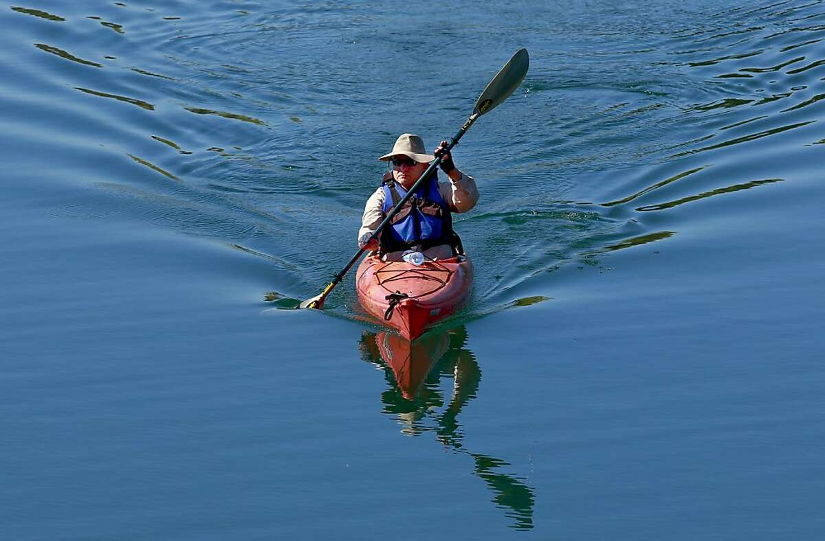 Ted McRice of Livermore paddles along the still waters of Shadow Cliffs regional park in Pleasanton, Calif. on Thursday June 27, 2013. Temperatures are predicted to climb all over the Bay Area and reach over the100 degree mark in the inland valleys by this weekend.
