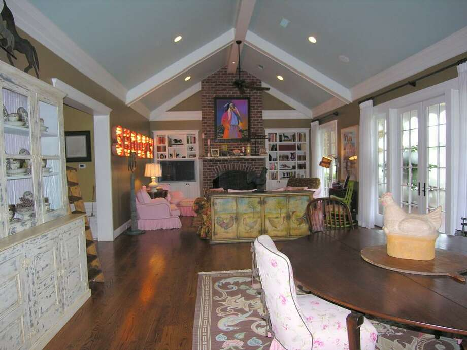MAIN HOUSE - Great Room with views to back, ceiling fan, recessed lignts, built-in cabinets and shelves with TV nook surround brick fireplace with gas.